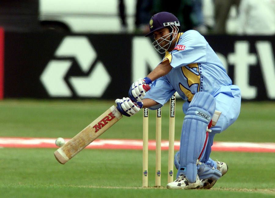 Sachin Tendulkar drives through the off side