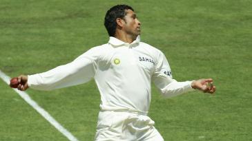 Non-striker Matthew Hayden watches Sachin Tendulkar bowl