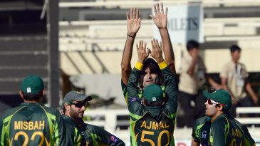 Mohammad Irfan celebrates with team-mates after dismissing Hashim Amla