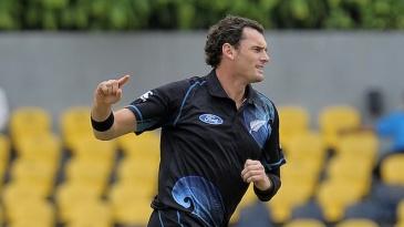Kyle Mills celebrates Dimuth Karunaratne's wicket