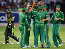 Lonwabo Tsotsobe celebrates a wicket with his team-mates, Pakistan v South Africa, 1st T20I, Dubai, November 13, 2013