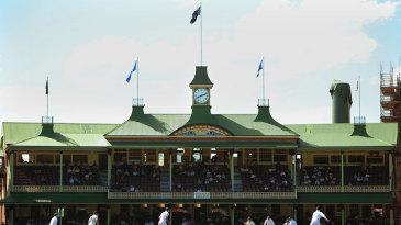 Graeme Swann bowls against the backdrop of the SCG pavilion
