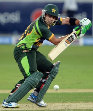 Umar Akmal guides one on the off side, Pakistan v South Africa, 1st T20I, Dubai, November 13, 2013