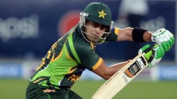 Umar Akmal guides one on the off side