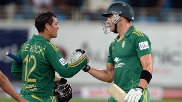 Quinton de Kock and Faf du Plessis celebrate the win