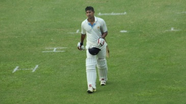 Ganesh Satish walks back after the day's play