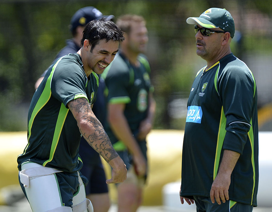 Darren Lehmann, sporting some extra facial hair, chats with Mitchell Johnson, Brisbane, November 15, 2013
