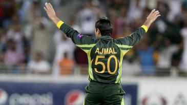 Saeed Ajmal celebrates the wicket of Quinton de Kock