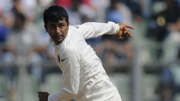 Pragyan Ojha in his delivery stride