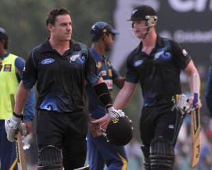 Nathan McCullum and James Neesham leave the field disappointed, Sri Lanka v New Zealand, 3rd ODI, Dambulla, November 16, 2013