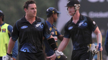 Nathan McCullum and James Neesham leave the field disappointed