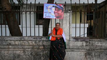 A lady holds a placard for Sachin Tendulkar
