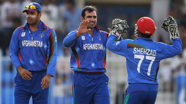 Samiullah Shenwari is congratulated after picking a wicket