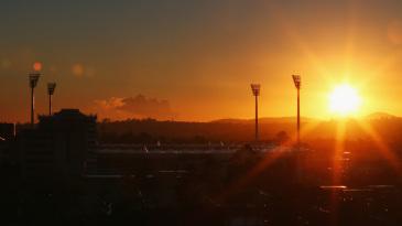 The sun rises over the Gabba