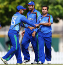 Karim Sadiq is congratulated by team-mates, Afghanistan v Bermuda, ICC World T20 Qualifiers, Dubai, November 20, 2013