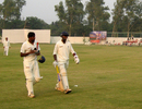 R Prasanna and Aswin Crist walk off after their unbroken stand of 79, Uttar Pradesh v Tamil Nadu, Ranji Trophy, Group B, 1st day, Meerut, November 21, 2013