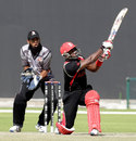 Damodar Daesrath slogs the ball during his 21-ball 30, United Arab Emirates v Canada, World Twenty20 Qualifiers, Group A, Abu Dhabi, November 22, 2013