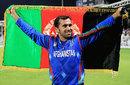 Karim Sadiq holds the Afghanistan flag after beating Nepal, Afghanistan v Nepal, ICC World Twenty20 Qualifiers, Group B, Sharjah, November 22, 2013