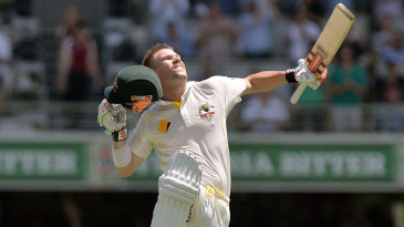 Jumping for joy: David Warner completes his first Ashes hundred