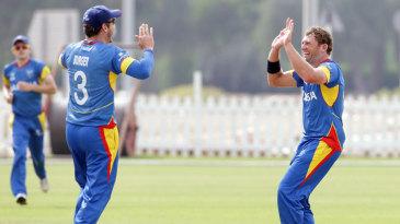 Nicolaas Scholtz and Sarel Burger celebrate a wicket