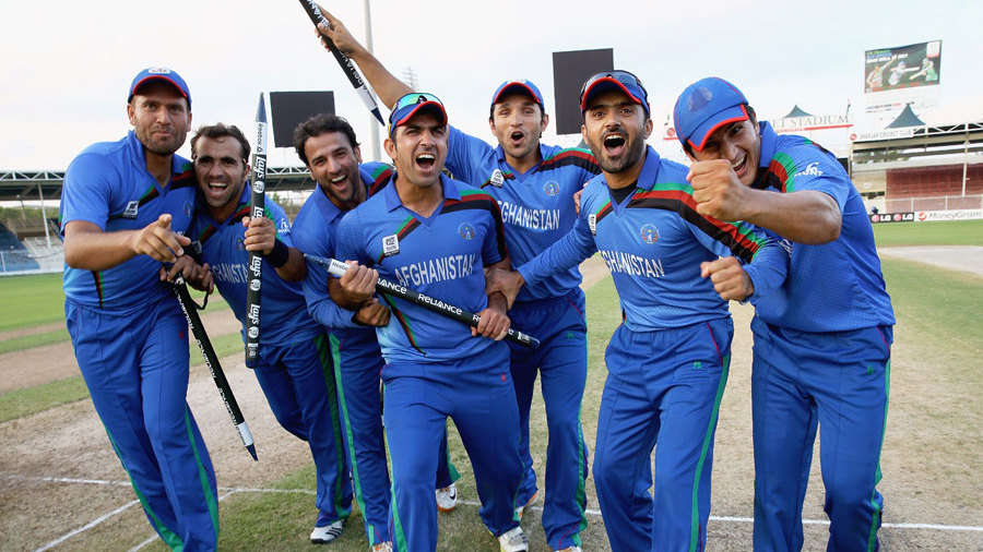 The Afghanistan players celebrate their 34-run win over Kenya
