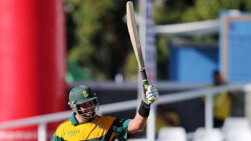 Jacques Kallis raises the bat after reaching his fifty