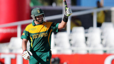 Jacques Kallis raises the bat after reaching his fifty