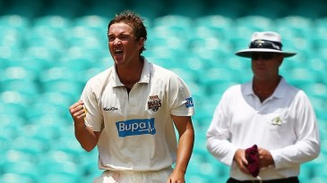 Nathan Hauritz celebrates a wicket