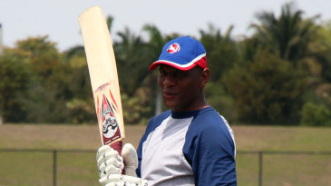 Neil McGarrell prepares to bat during a practice session