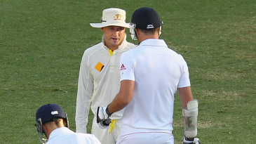 Michael Clarke and James Anderson exchange words