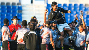 UAE players celebrate with coach Aaqib Javed after qualifying for the World T20