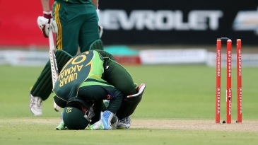 Umar Akmal is in pain after being struck on the knee