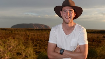 Stuart Broad poses in front of Uluru