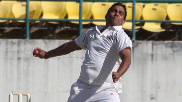 Vikramjeet Malik gets ready to release the ball