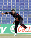Moner Ahmed bowling during the Papua New Guinea v Hong Kong Qualifying Final match at the ICC World Twenty20 Qualifiers at the Zayed Cricket Stadium on November 28, 2013 in Abu Dhabi, United Arab Emirates. (Photo by Graham Crouch-IDI/IDI via Getty Images)