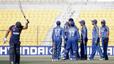 Afghanistan celebrate the wicket of Sagar Pun