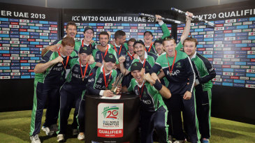 The Ireland players celebrate with the World Twenty20 Qualifiers trophy