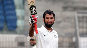 Cheteshwar Pujara acknowledges the crowd after reaching a double-century