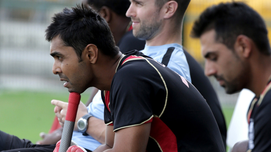 Canada's captain Ashish Bagai watches the match from the bench