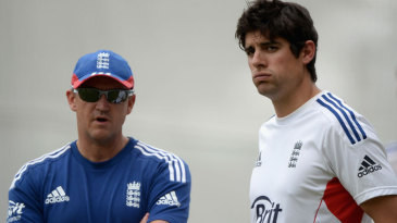 Andy Flower and Alastair Cook look on