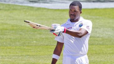 Darren Bravo raises his bat after reaching his fifth Test century