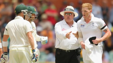 Umpire Marais Erasmus steps in to ensure the confrontation between Ben Stokes and Brad Haddin does not become too heated