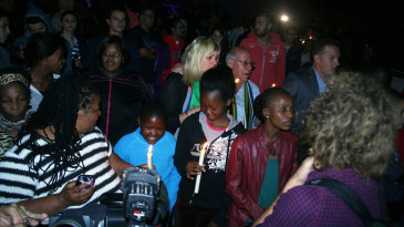 People gather outside Nelson Mandela's house to pay tribute to the leader