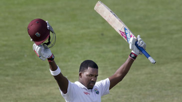 Darren Bravo raises his bat after reaching 200