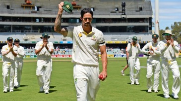 Mitchell Johnson leads the Australians off after taking 7 for 40