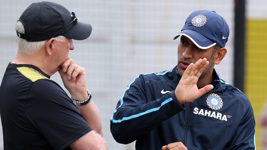 MS Dhoni has a chat with Duncan Fletcher