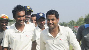 Padmanabhan Prasanth (right) and Vinoop Manoharan picked up seven wickets