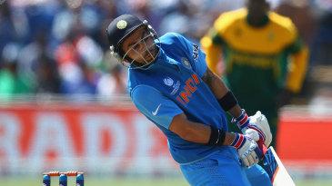 Virat Kohli is hit by a short ball