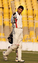 Nitin Saini sneaks a look at the camera after reaching a century, Gujarat v Haryana, Ranji Trophy 2013-14, Group A, 2nd day, Ahmedabad, December 15, 2013