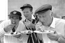BBC commentators Fred Trueman, Christopher Martin-Jenkins and Brian Johnston eat cake, London, May 23, 1989
